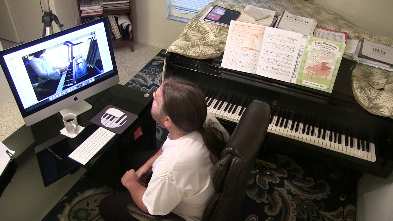 Cory teaching a piano lesson via Skype
