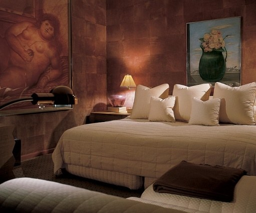 Large canvases by Fernando Botero set the scale for a bedroom designed in 1981..jpg