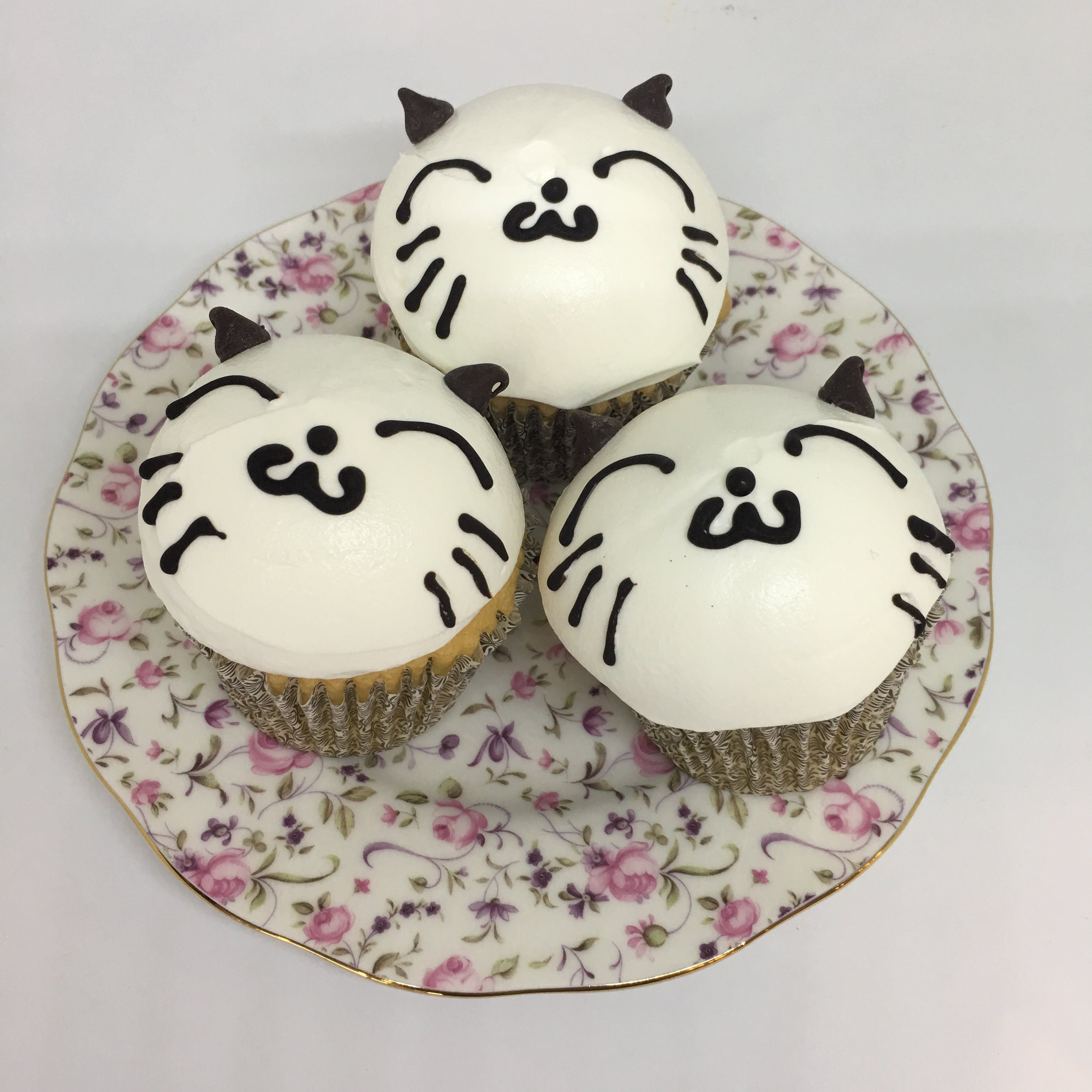 KITTEN CUPCAKE with heavy cream topping (available at Kam Shopping Center location only)