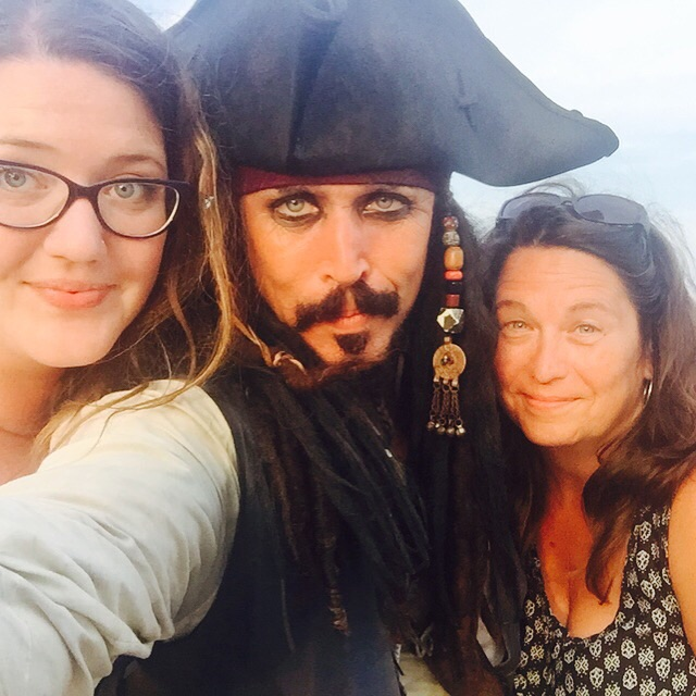 My aunt insisted we take pictures with the pirate, he made fun of my short arms and the three of us scuffled 180 degrees to not have the sun in our eyes. He was kind of creepy, but it was hilarious.