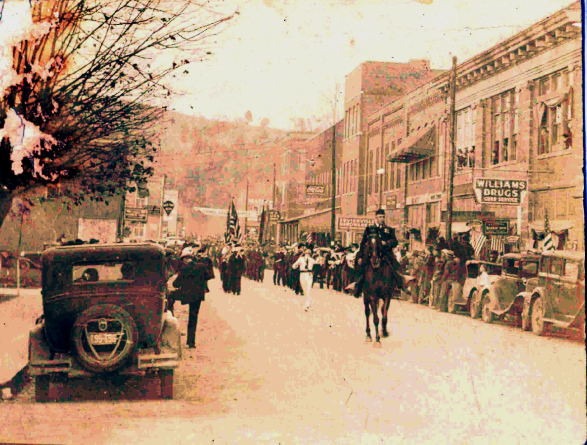 "THOSE are my windows at the top right of the picture, above and to the right of the ""Williams Drugs"" sign. The picture here is the parade for the guys returning from WWI."