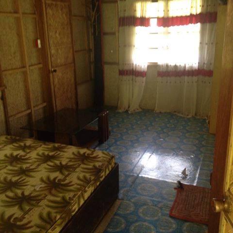 A dormitory room with a bathroom.jpg