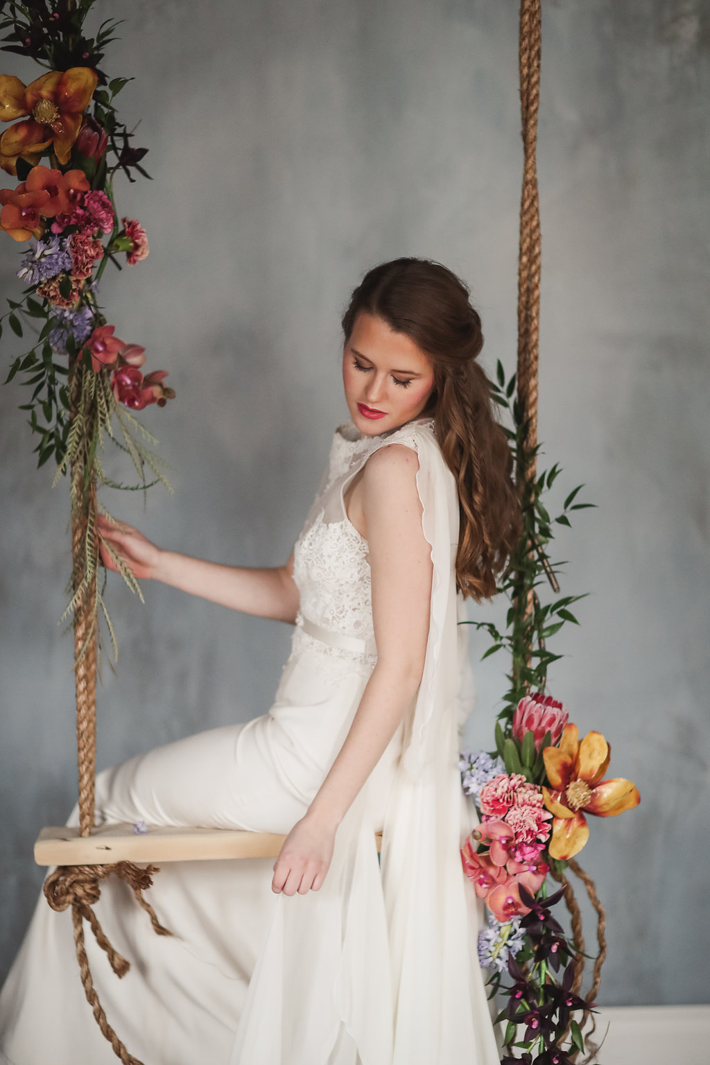 The lovely Amber modeling a dress by Eugenia Couture on our in house swing (did I mention we installed a swing?!?!) with gorgeous florals by Allium Design, hair and make up provided by Nicole Lynne