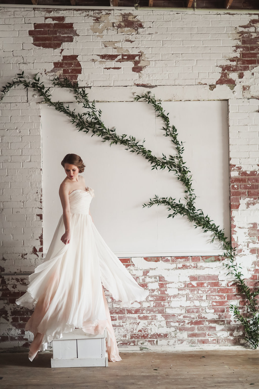 Another incredible gown by Eugenia Couture featuring a floral installation by Allium Design