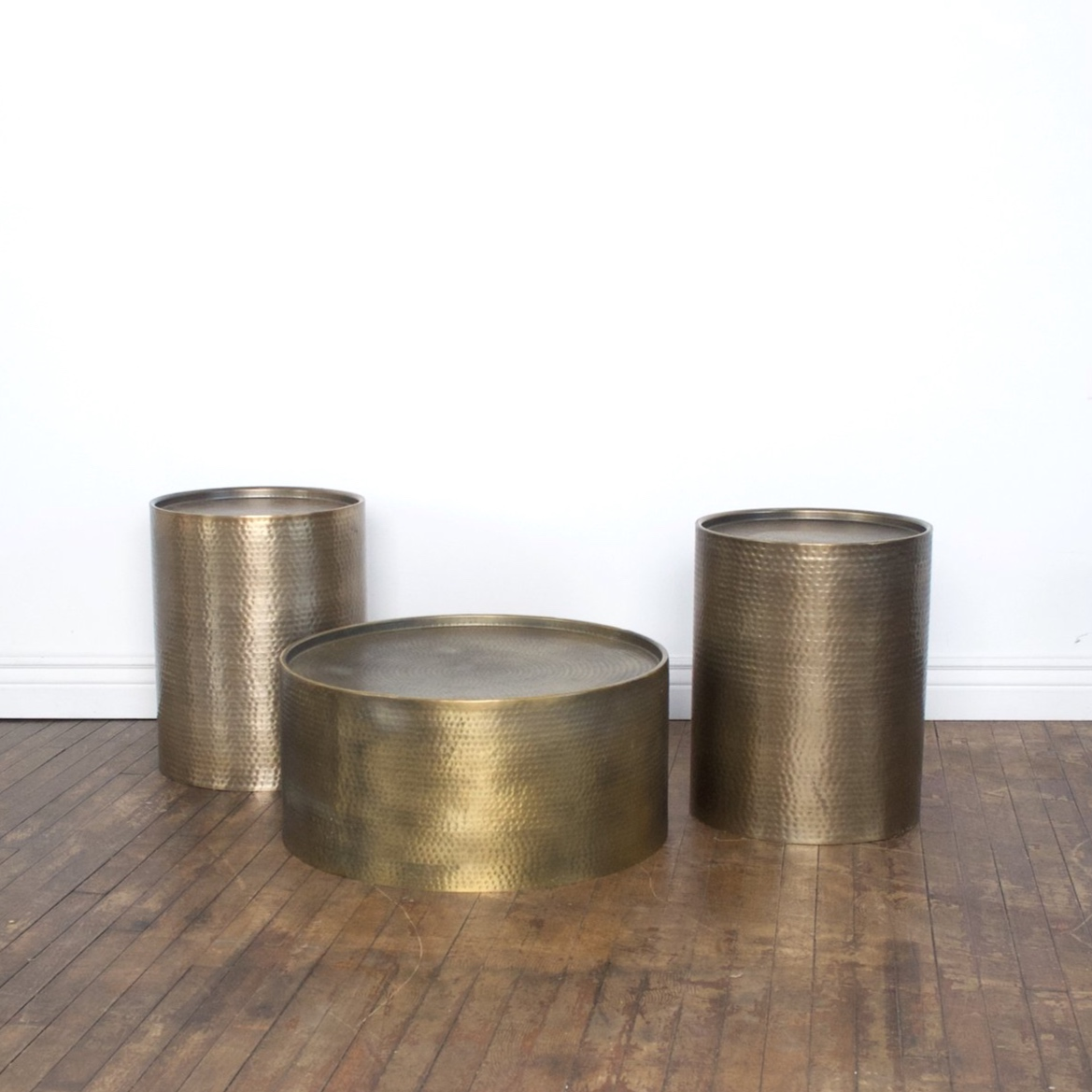 """Dimpled Brass Tables    $80 set side 16""""d    21""""h / coffee 26""""d 12""""h"""