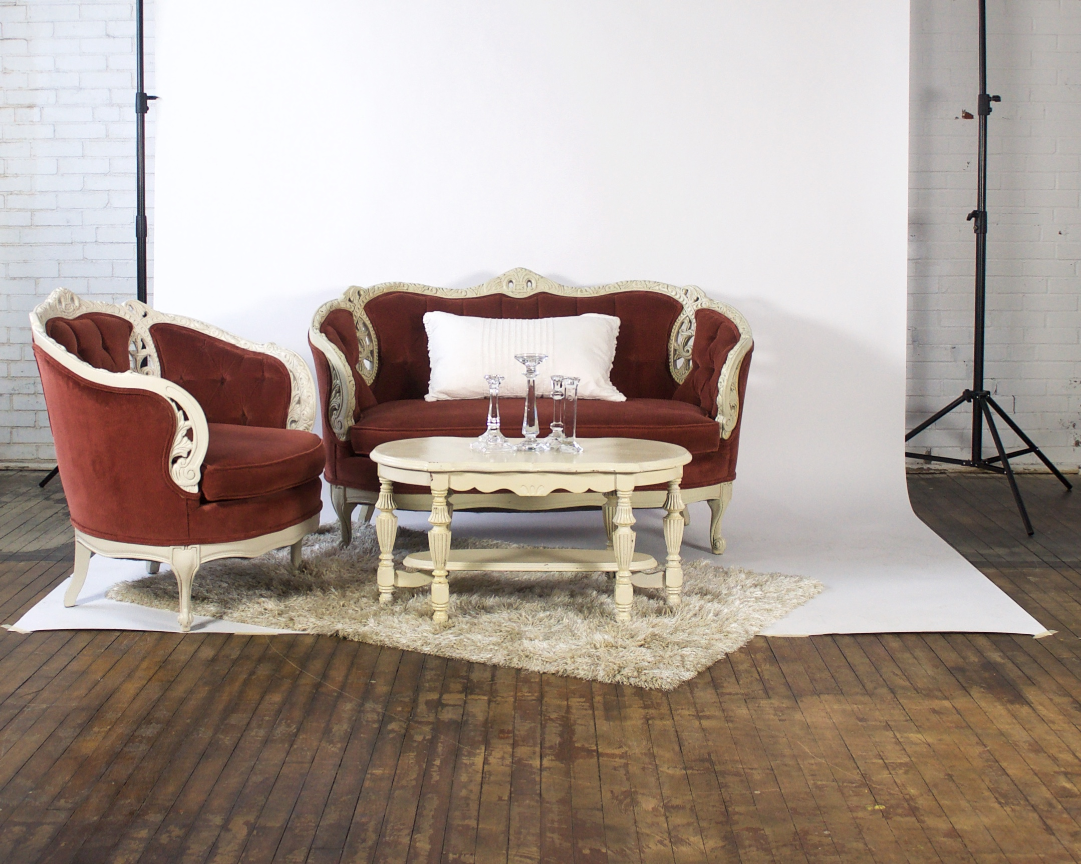 Cinnamon and Cinnamon Petite - featuring shaggy champagne rug and white coffee table