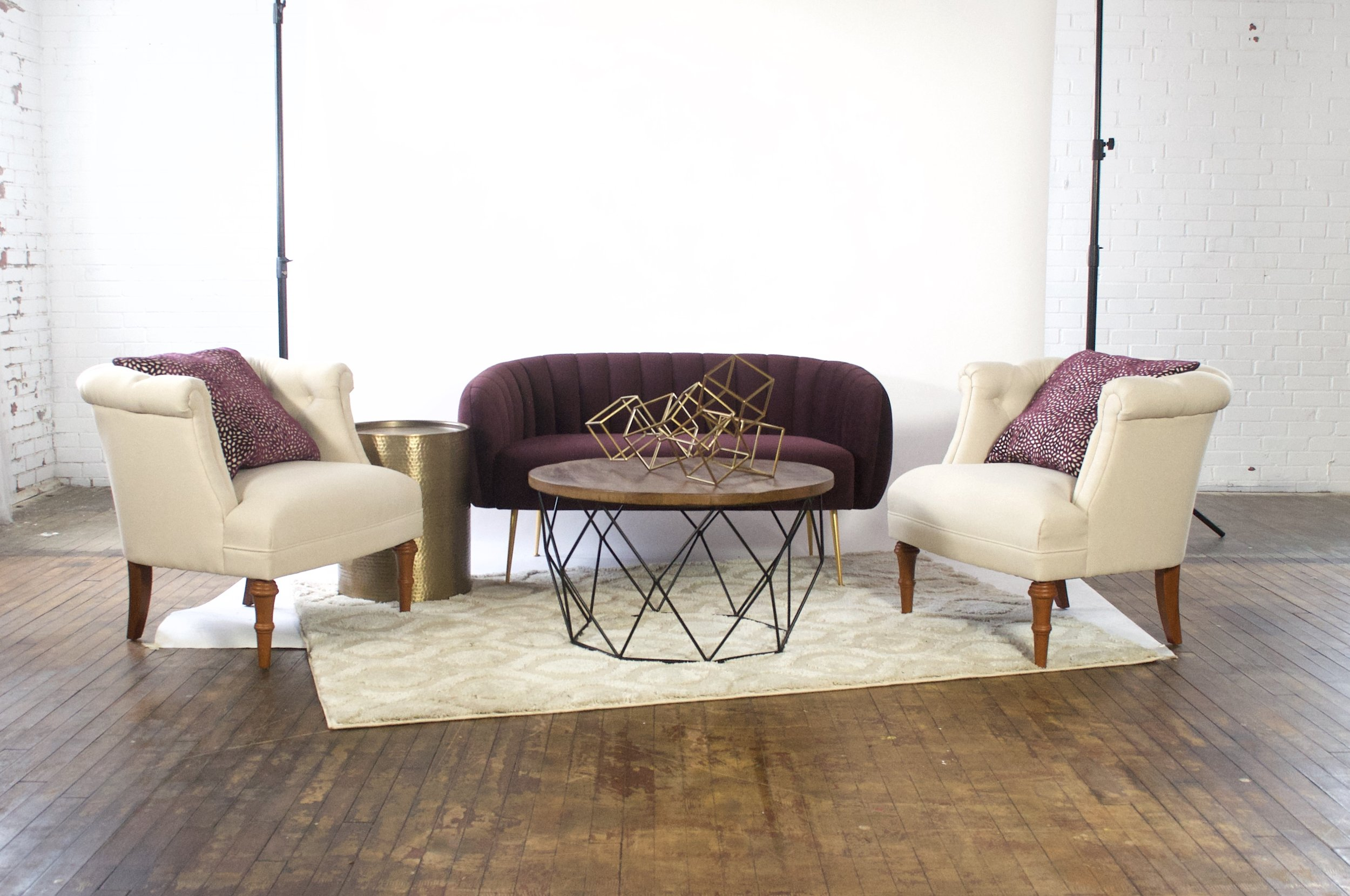 Phyillis and Bonnie Demi - featuring moroccan cream rug, baxter coffee table, dimpled side table