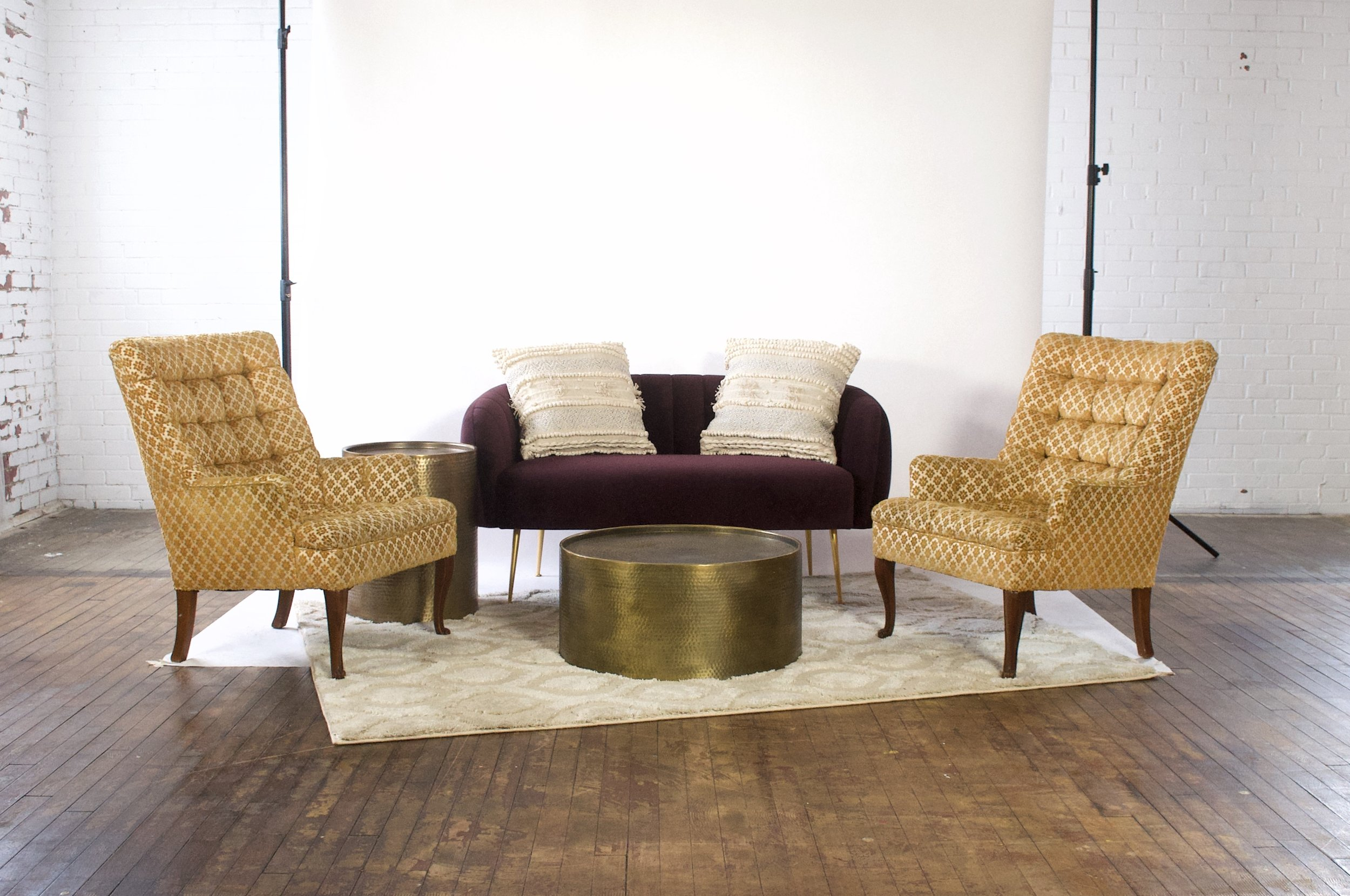 Phyllis and Seth Demi - featuring moroccan cream rug, and dimpled brass tables