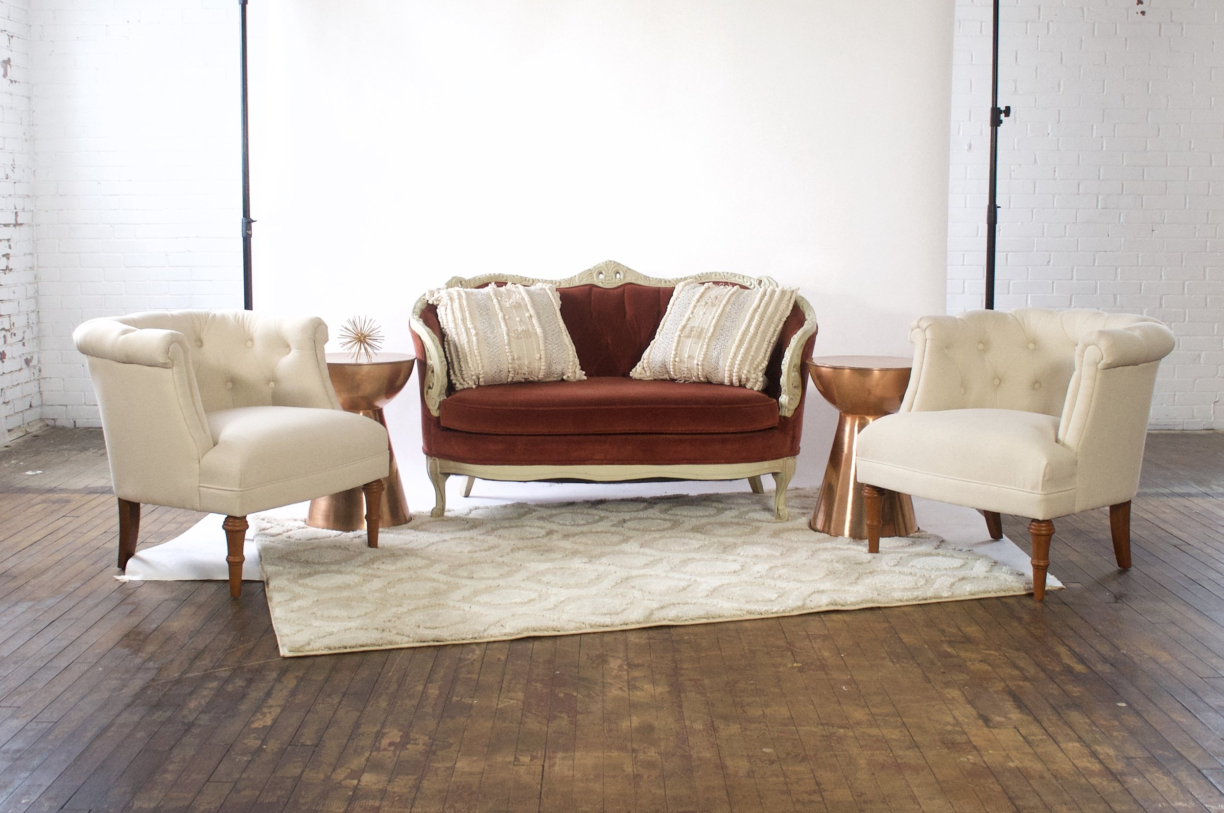 Cinnamon and Bonnie Demi - featuring mococcan cream rug and copper side tables