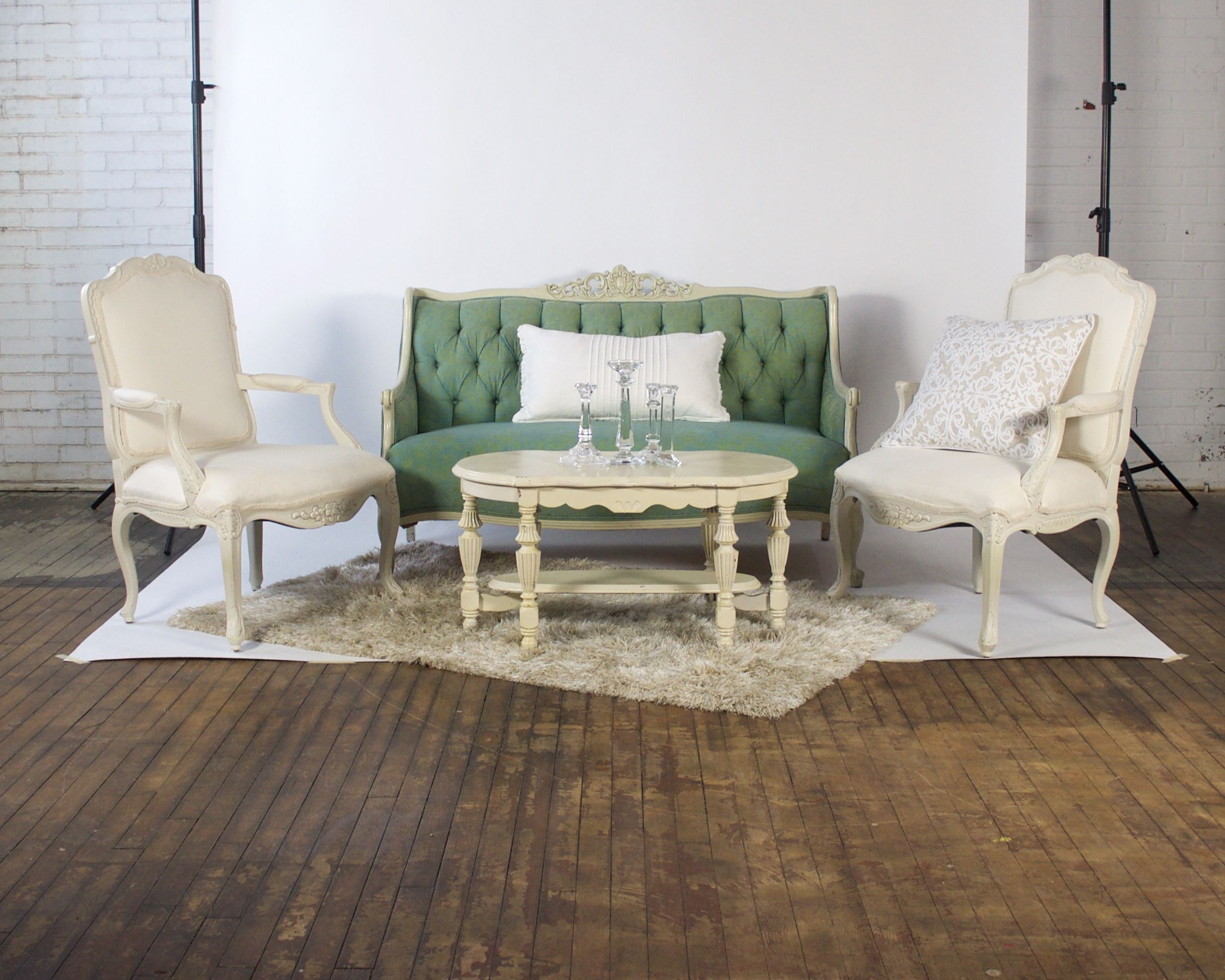 Mint and Kat Demi - featuring shaggy champagne rug, white coffee table and white pedestal