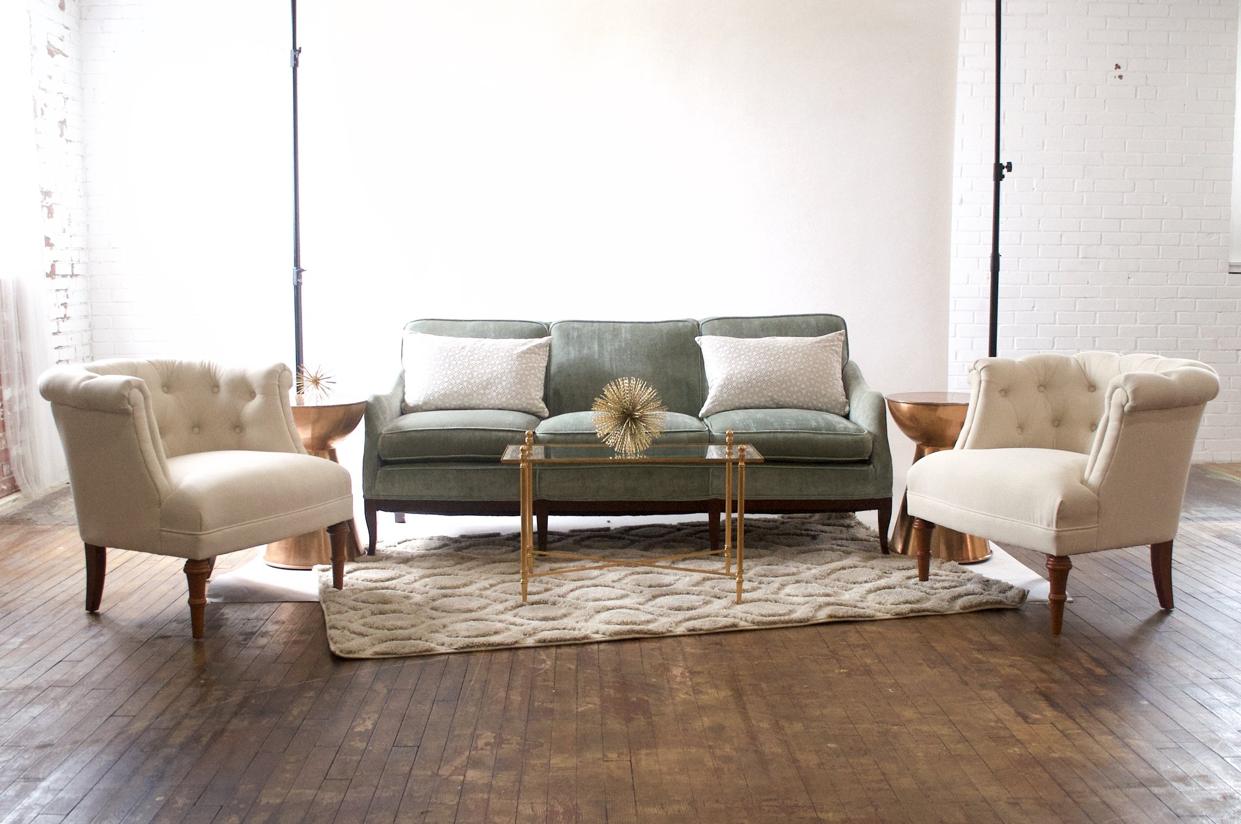 Emily and Bonnie Grand - featuring morroccan cream rug, gold and glass rectangular table and copper side tables