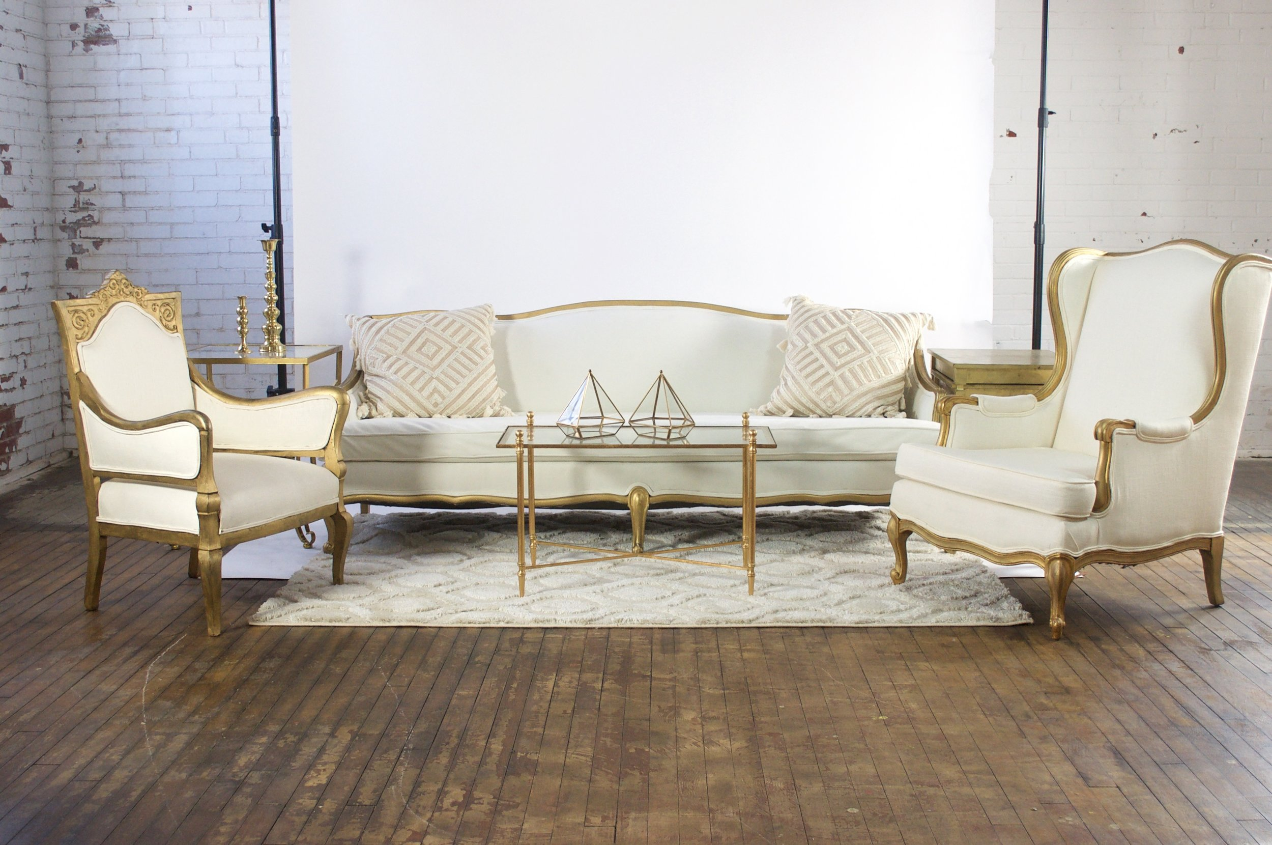 Eleanor and Leo Grand - featuring morroccan cream rug, gold and glass rectangular table, gold square top table and gold stacking tables