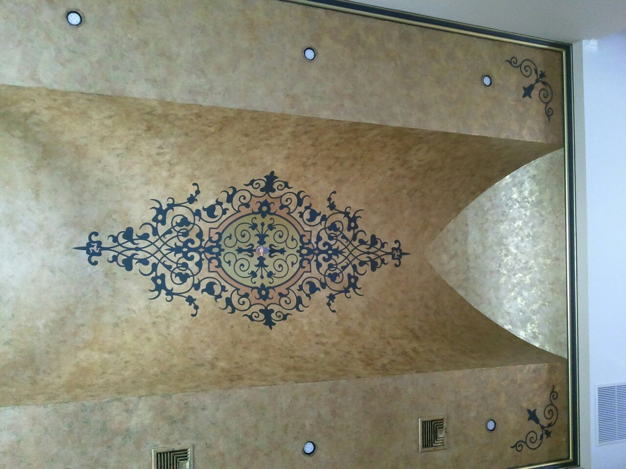 metallic gilded ceiling with medallion