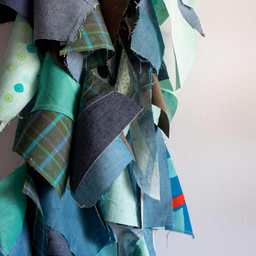 Improvisational quilt WIP, chain pieced fabrics