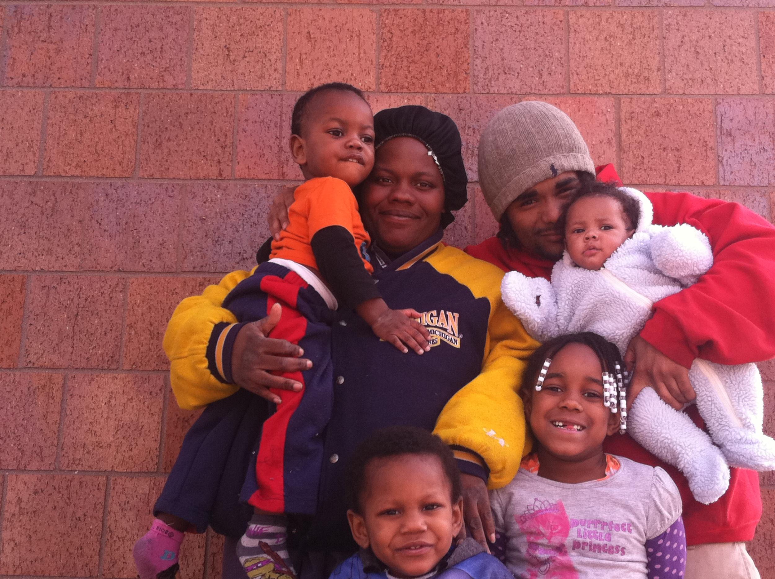 Darren, Cassandra, and their four children, left to right, Cameron, Camari, Carissa, and Junior.
