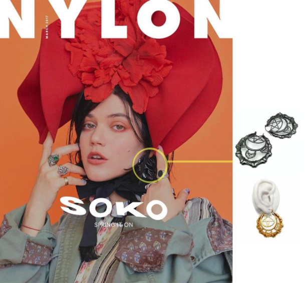 Musician/actress SOKO wears the SANTE SANGRE earrings on the March 2017 cover of NYLON MAGAZINE