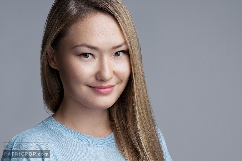 A natural and beautiful Headshot of Senior Financial Analyst Zhanara Smakova