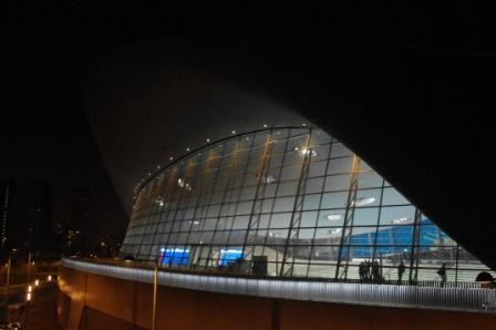 The aquatic centre glowing in the dark.