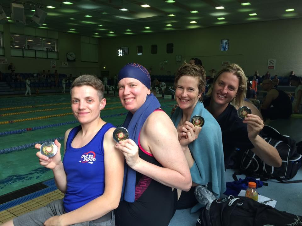 Women freestyle relay winning a gold