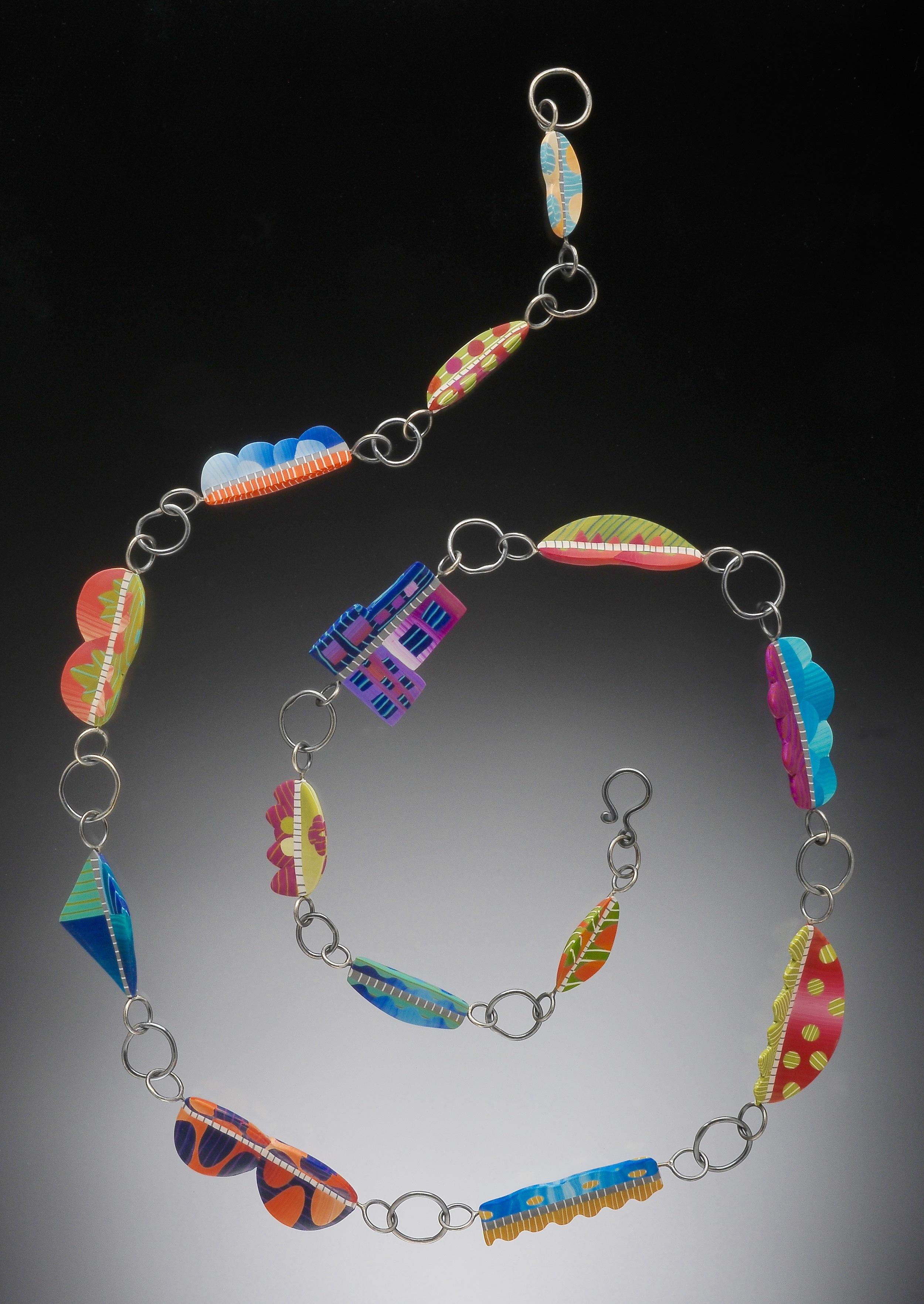 geometric songbird necklace