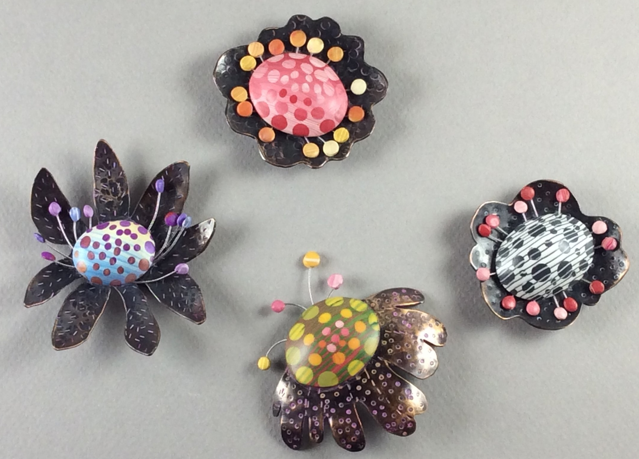 """Petal Bop Pins 2018  polymer clay millefiori marquetry, patinated bronze and copper, sterling silver, stainless steel wire, acrylic paint  2"""" x 2"""" x .375"""" D"""