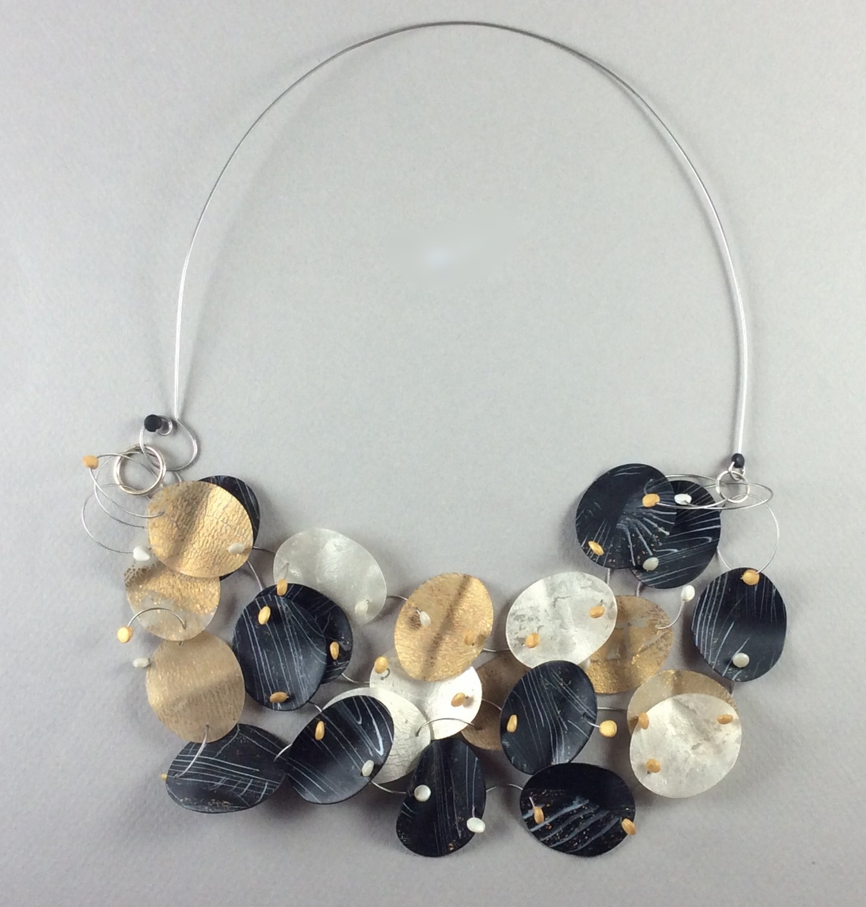 """Floating Necklace 2018  Polymer veneer, stainless steel wire, patinated sterling silver  7"""" w x 3"""" H"""