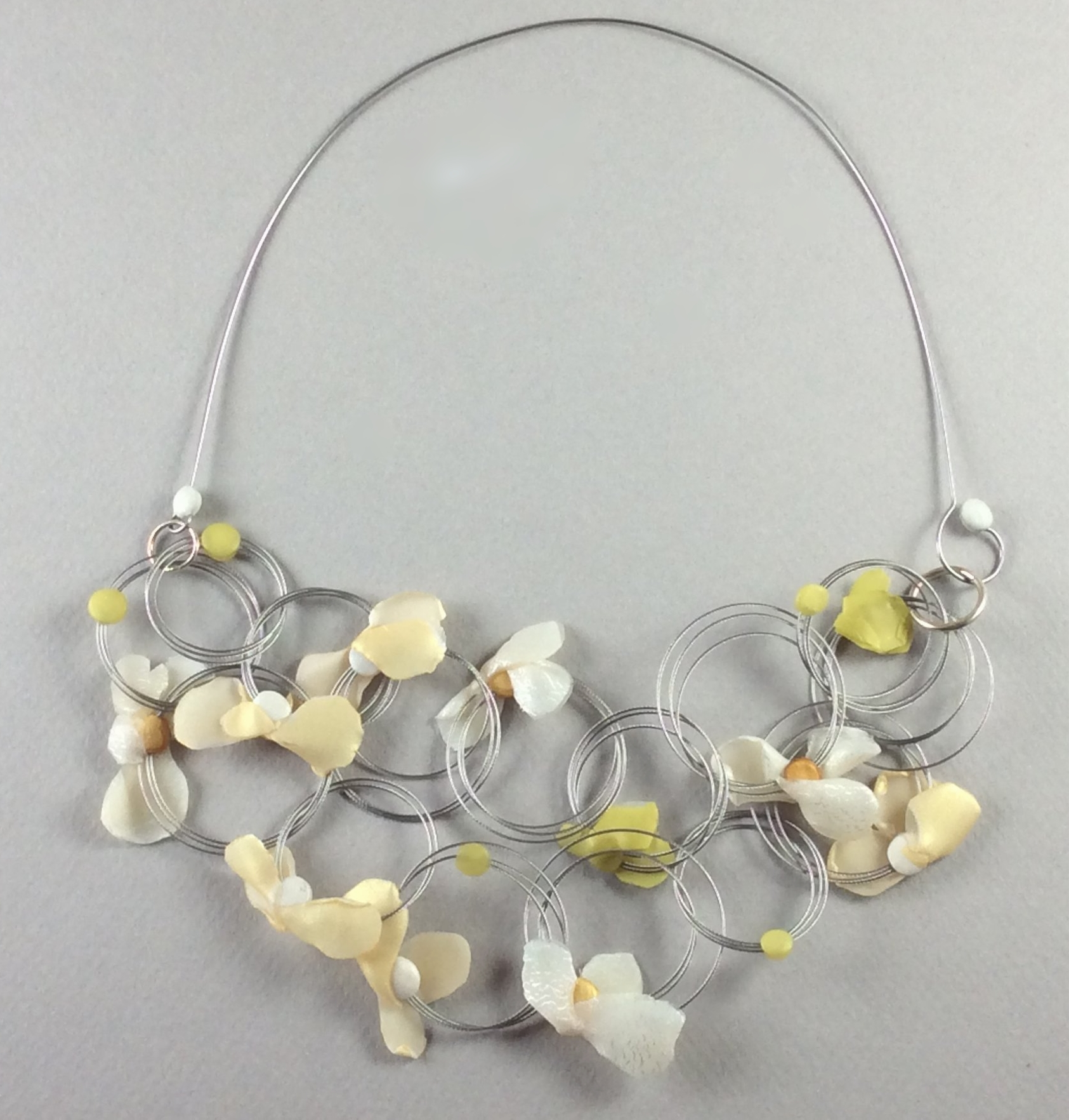 """Floating Petal Necklace 2018  Polymer veneer, stainless steel wire, patinated sterling silver  7"""" w x 3"""" H"""