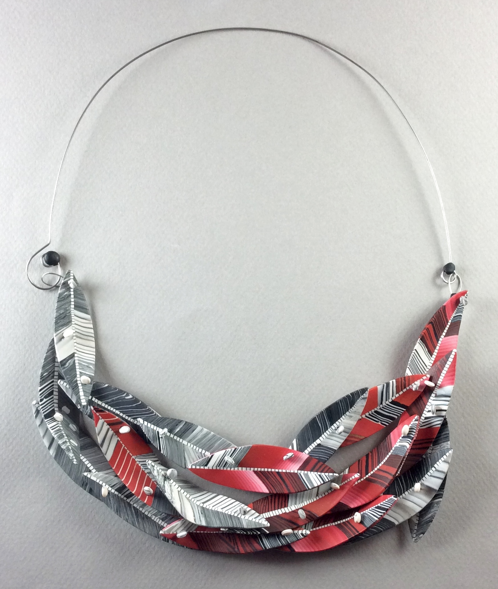 """Winter Bird Necklace 2017  Polymer veneer, stainless steel wire, patinated sterling silver  7"""" w x 3"""" H"""