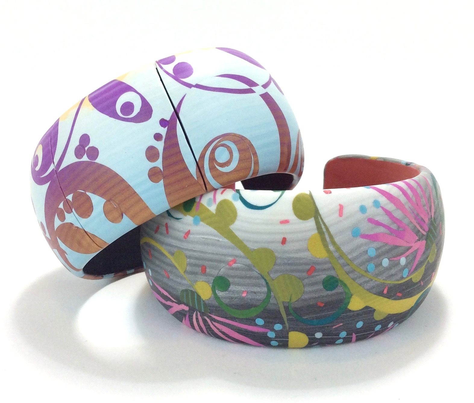 "Veneered Cuff Bracelets   2018  Polymer clay marquetry veneer, nickel silver armature, apoxy clay core  9"" circumference  x 1.5"" w"