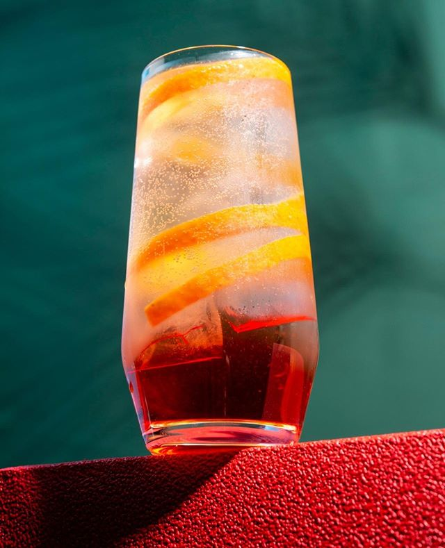 "A Killer with Spritz - our Signature Drink ""Agent Aperitivo"" is already a classic. Combining italian style Amaro with Prosecco, Soda and a lot of ice. Weekend here we come...⁠ ⁠ ⁠ Looking for some great drinks for your next event or some tasty afterwork cocktails in your office? Let's talk!⁠ ⁠ ⁠ #mixology #barcatering #instadrinks #instacocktails #berlin #drinkoftheday #craftspirits #amaromondino #prosecco #catering #bar #berlinbars #berlindrinks #picoftheday #summerdrinks #sektgar #cocktails  #afterwork  #officedrinks #mixologist #drinkporn #berlinfood #drinkcontent #drinkdesign ⁠"