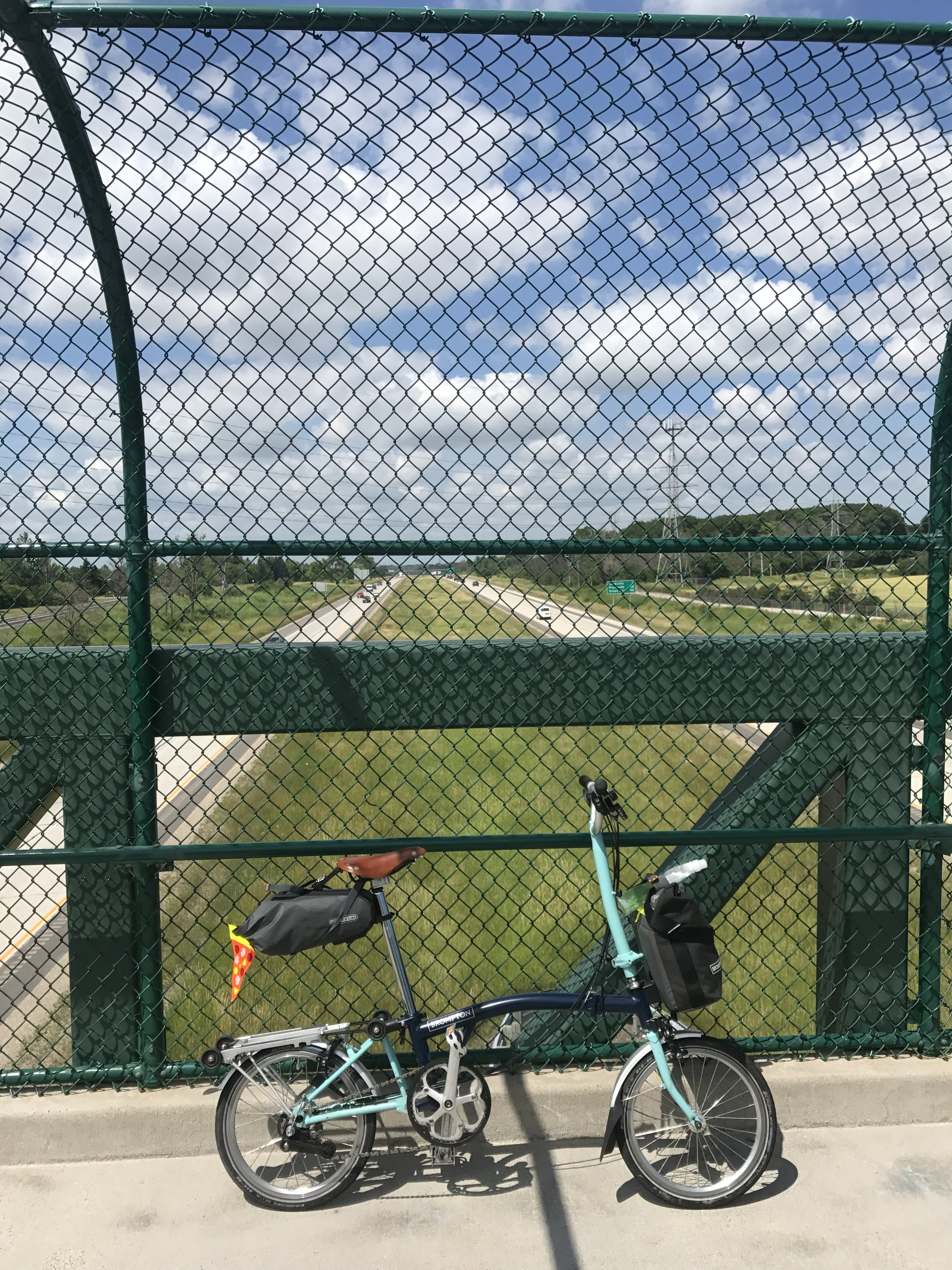 Tiny but mighty Brompton above the big interstate highway
