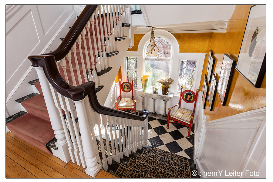 Pomegranate Inn , Portland, Maine - view of stairs from the second floor.
