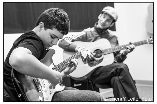 Music teacher, Matt Wasowski teaching Gorham Music School student to play the blues.