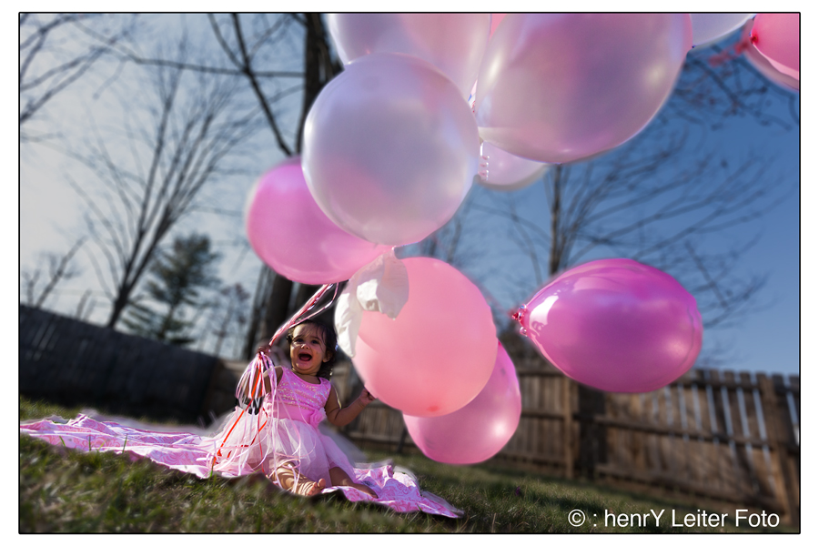 Isabella releasing ballons at her one-year birthday party.