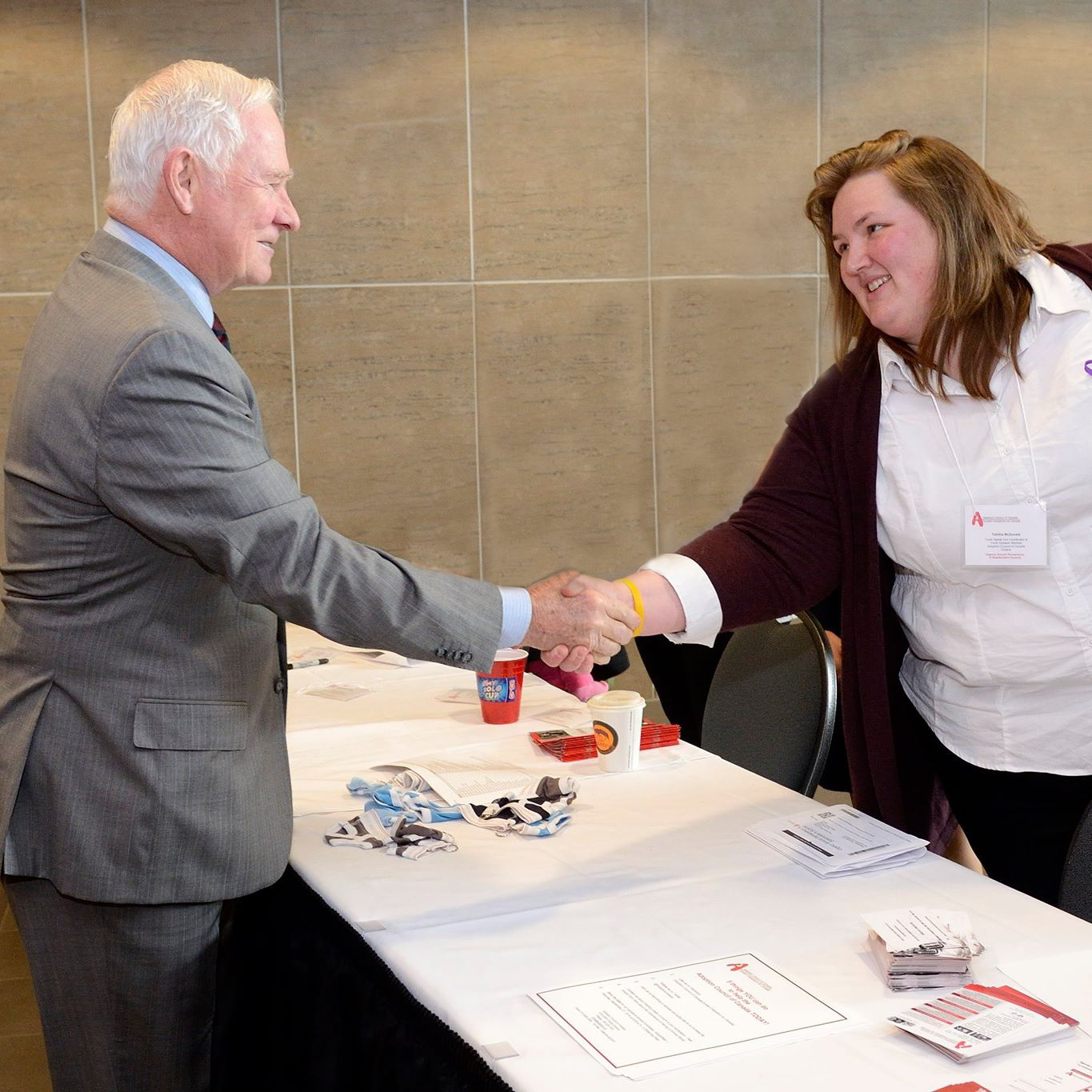 Tabitha shaking hands with Our Governor General the Honourable David Johnston at the Adoption Council of Canada's Urgency Around Permanency Summit.