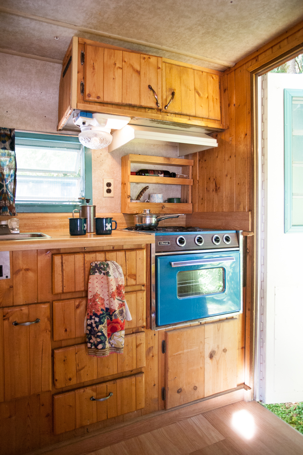 The kitchen is my favorite part of Lucille, because we both love to cook and there is just enough room for dancing! The original oven was one of the main selling points, not only does it work, but it happens to be my favorite color.
