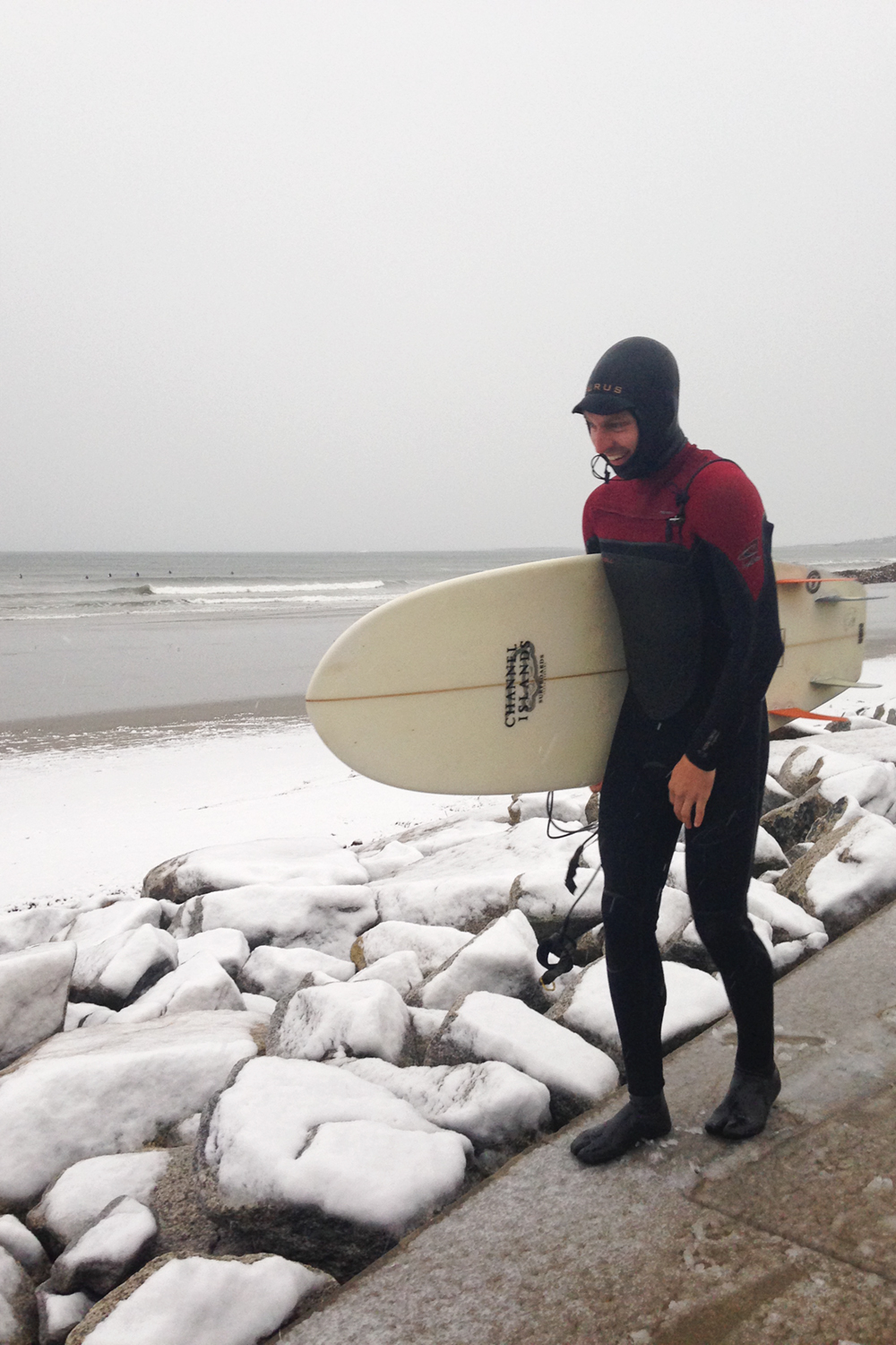 With the storm came wind-swell that created perfect little waves. Adam was beyond stoked to surf in the snow! Air temp was 35 and the water was 55. Burrrr. It was a first for him and will not be the last.