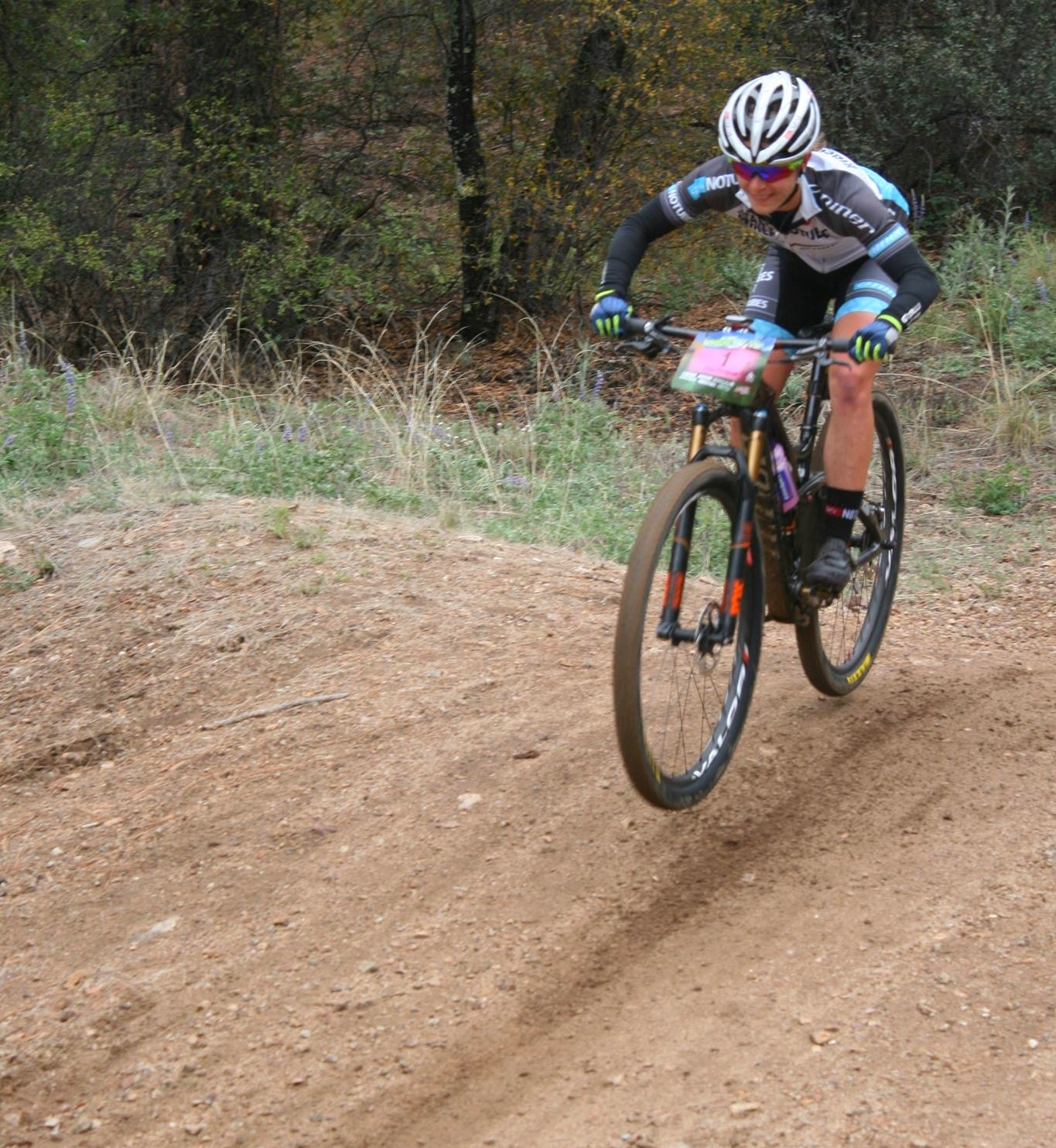 All smiles at the bottom of Trail 260. Thanks to Alex & Drew Shumaker for cheering and the photo!