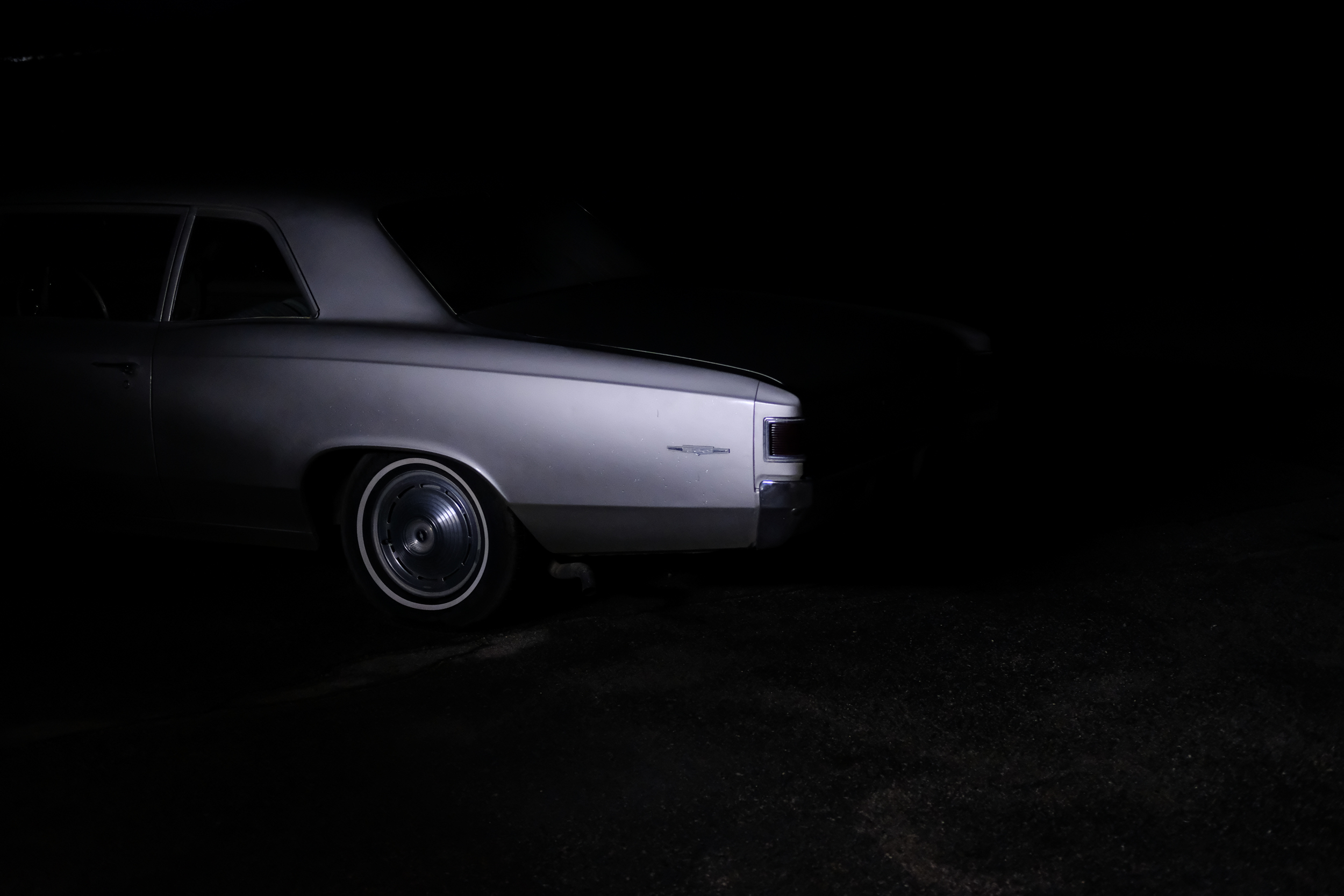 … at that moment the neon lights went out and I was left standing in the pitch black parking lot with only the sound of tires rolling across gravel towards the highway.