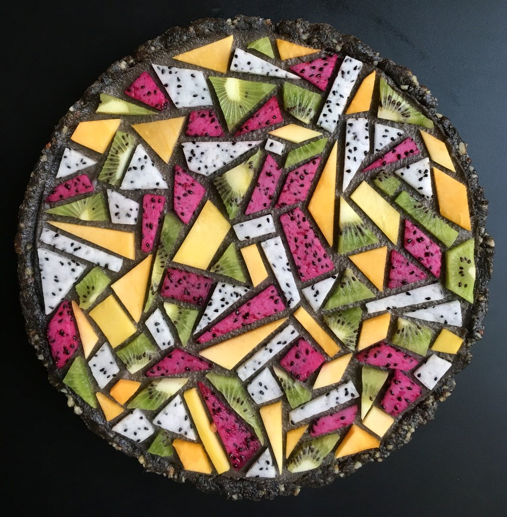- black sesame tarte with colored tangrams