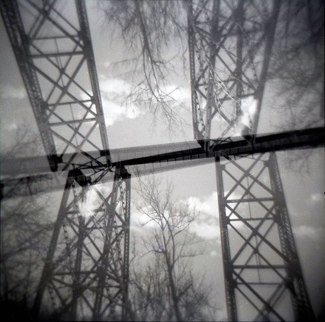 Railroad trestle, early spring (2019) ⠀⠀⠀⠀⠀⠀⠀⠀⠀ ⠀⠀⠀⠀⠀⠀⠀⠀⠀ ⠀⠀⠀⠀⠀⠀⠀⠀⠀ #filmphotography #holga #120film #doubleexposure #mediumformat #analogphotography #expiredfilm #blackandwhitephotography