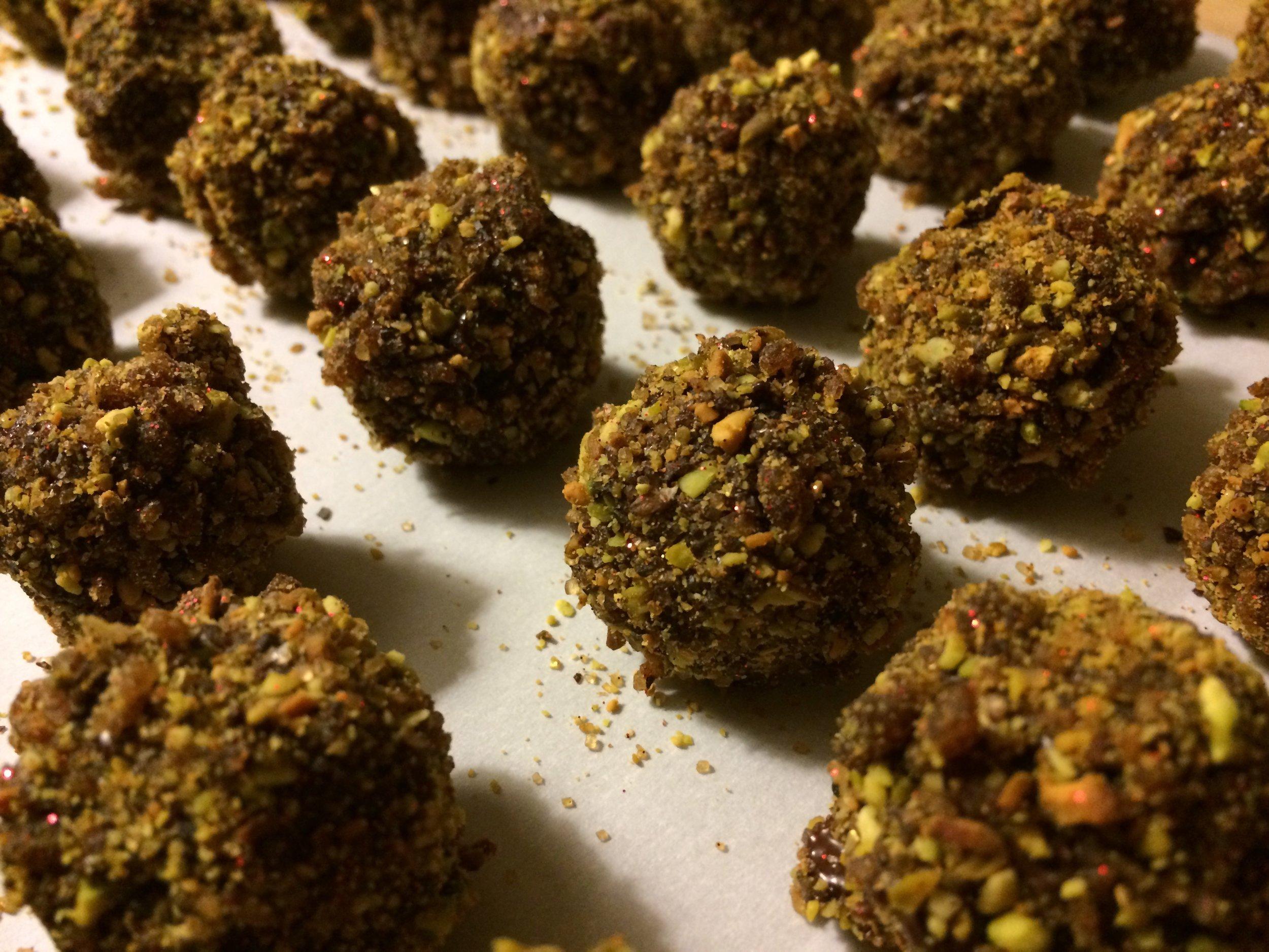 Vegan, pomegranate and pistachio truffles