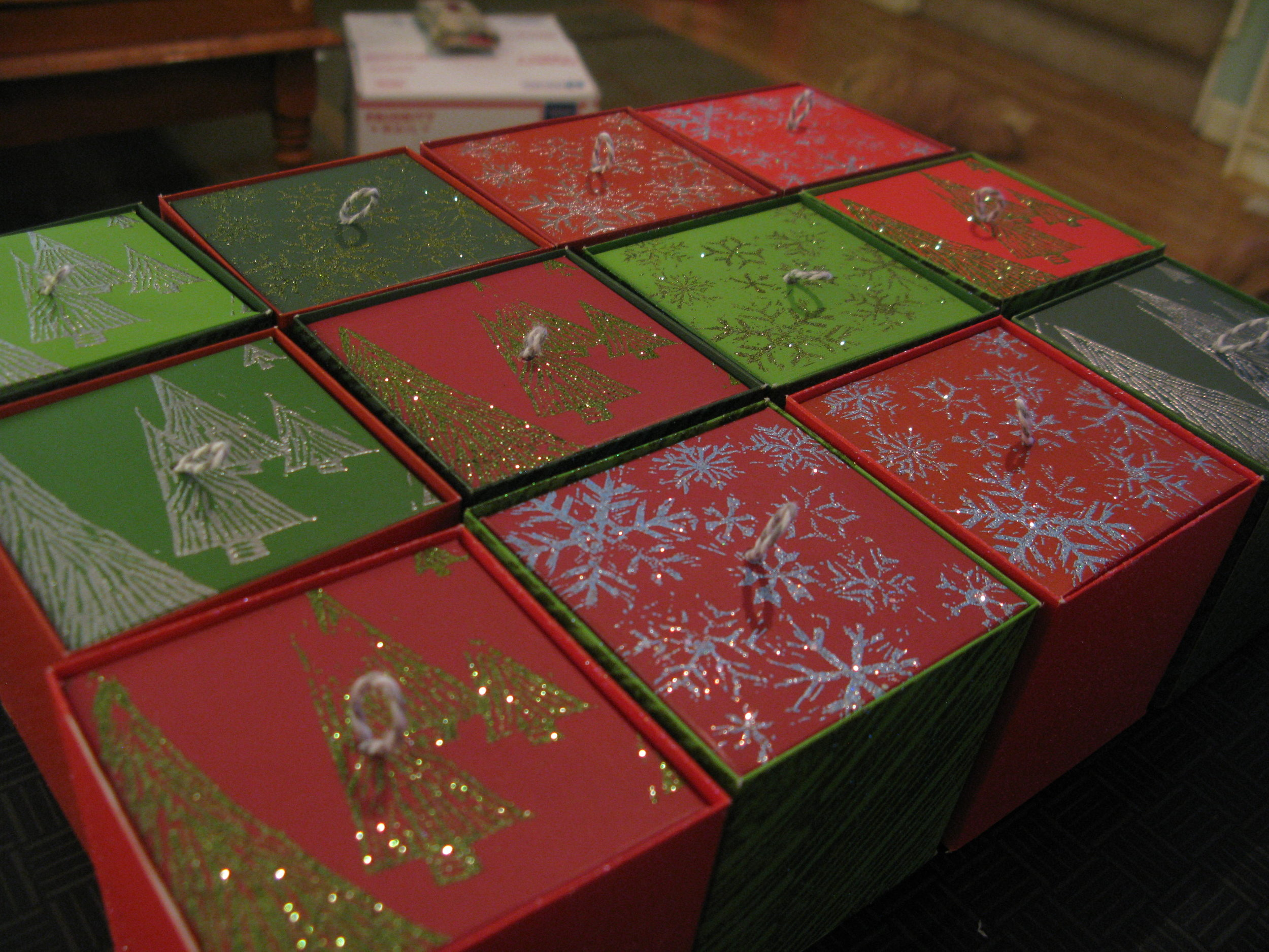 Boxes made from scrapbooking paper, decorated with hand cut stamps