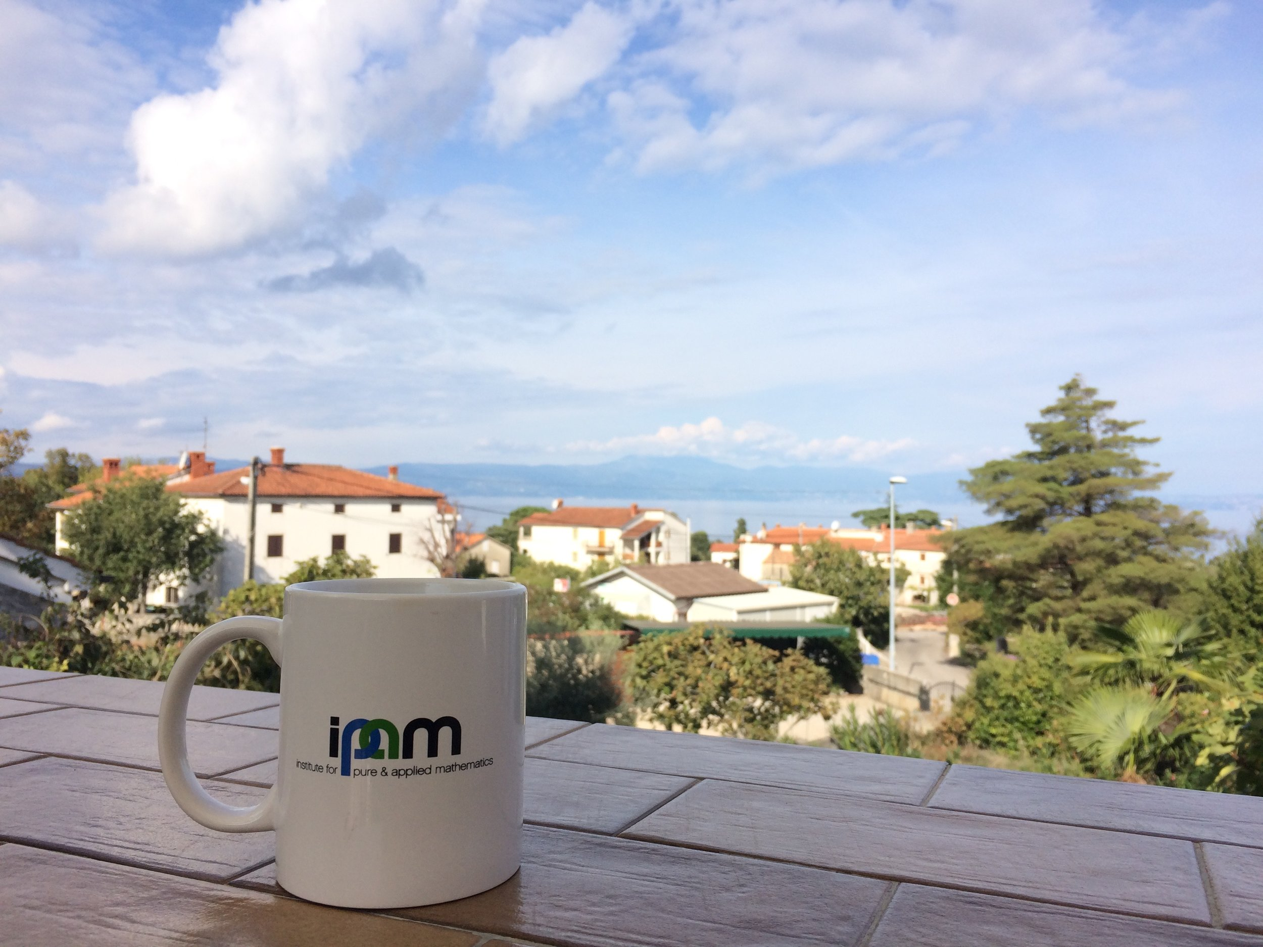 From a solo road trip through Europe. This is at a good friend's house in Croatia, with a mug from IPAM which hosted the program where we met.