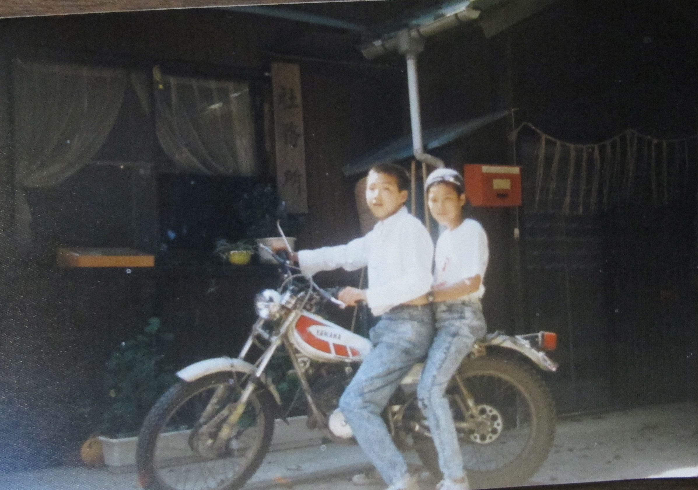 keino and his brother Rintaro on their first motorcycle