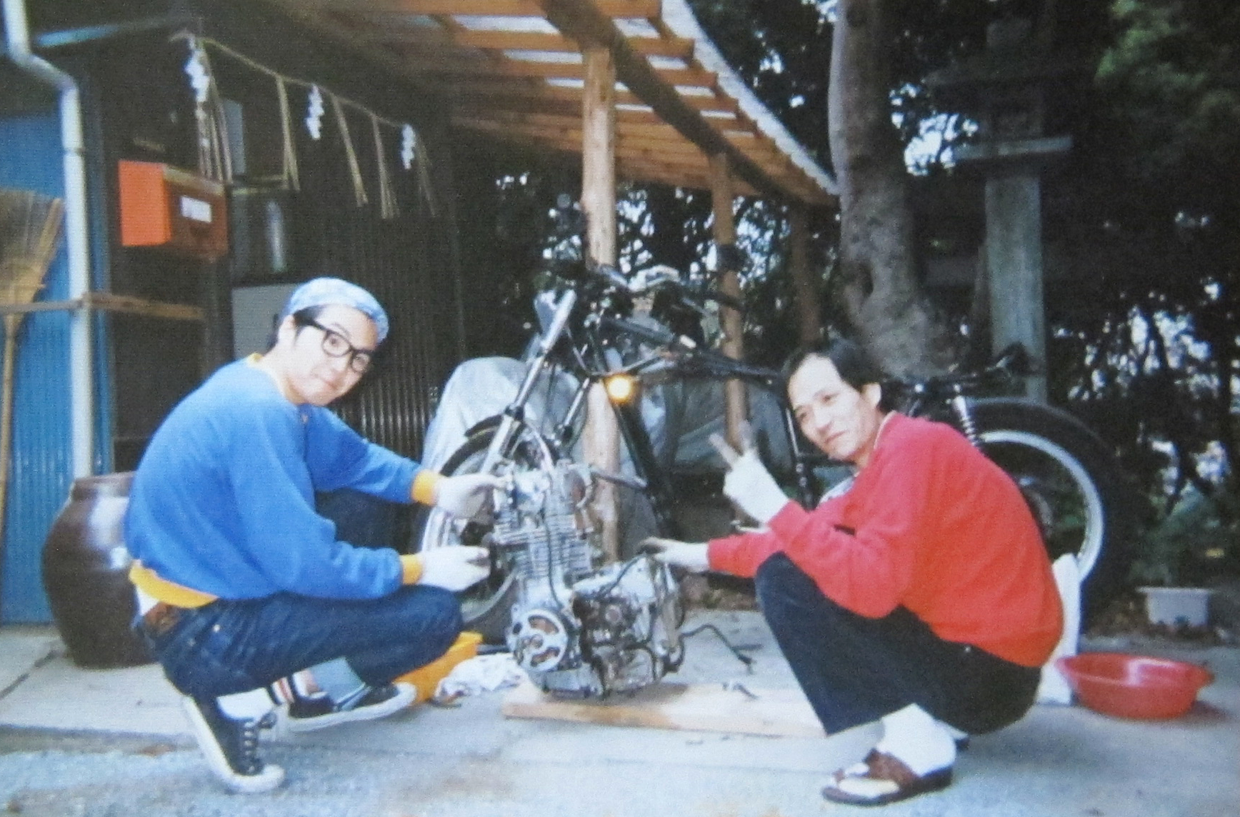 Keino and father  taking apart XS650