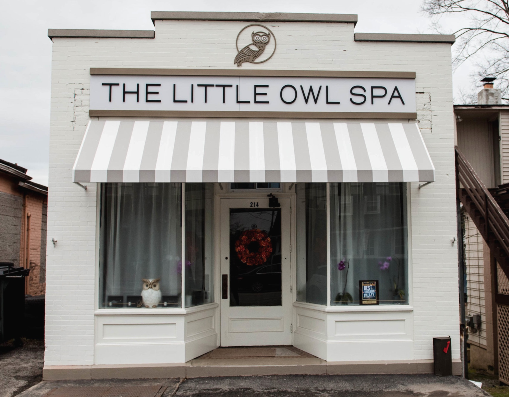 The Little Owl Spa - LOCATIONWe are located at 214 Hooker Ave. in Poughkeepsie, NY. If you are heading east on Hooker Ave, we are on the right side next to an auto body shop called Doc Noc. Our building is white and we have a gray and white awning with the emblem of the little owl above. You can't miss us!