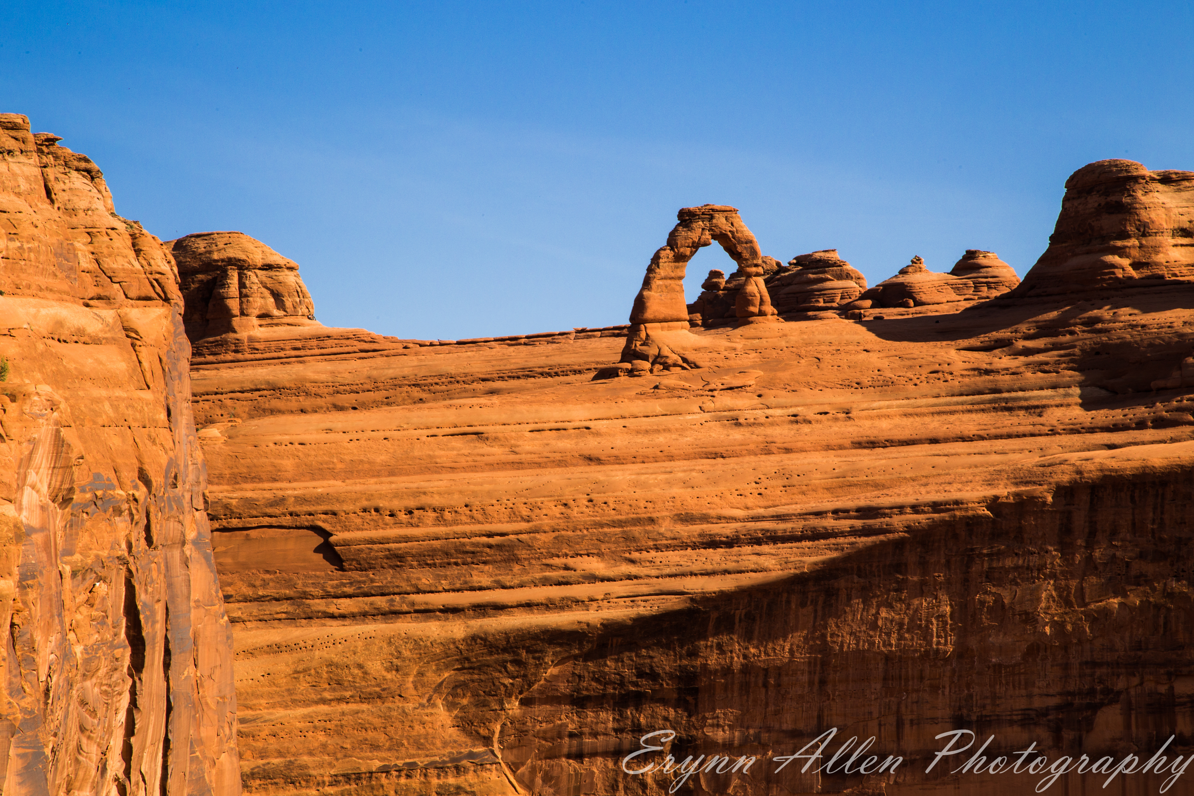 Delicate Arch at a distance from Upper Viewpoint. There are thirteen people cloned out of this image.