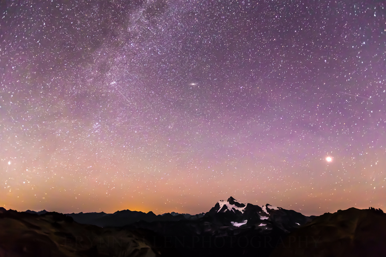 The Milky Way, Andromeda, and the moon, from left to right, hovering above Mount Shuksan and the North Cascades.