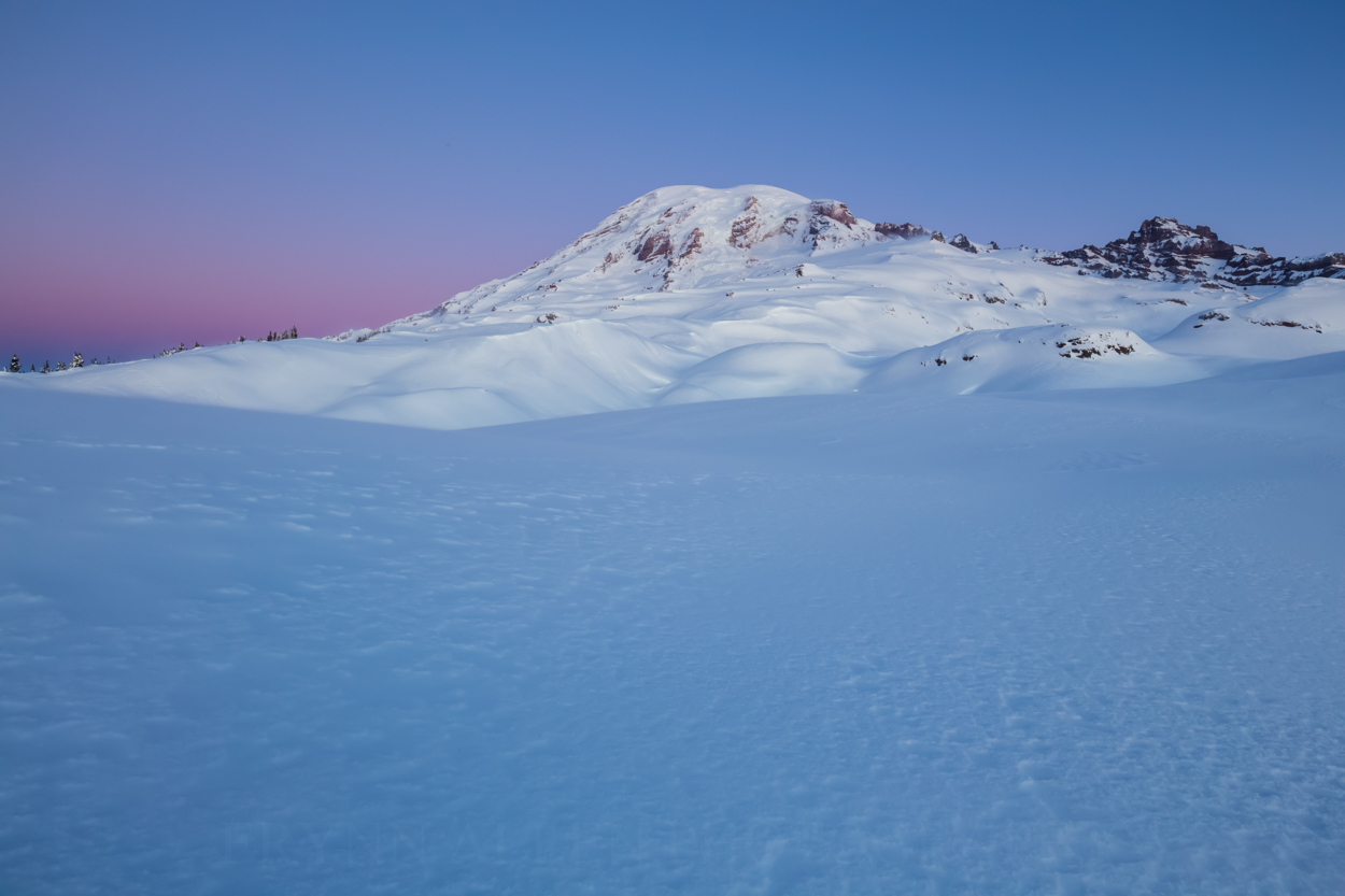 The mountain standing silently before the morning light began to kiss its summit,